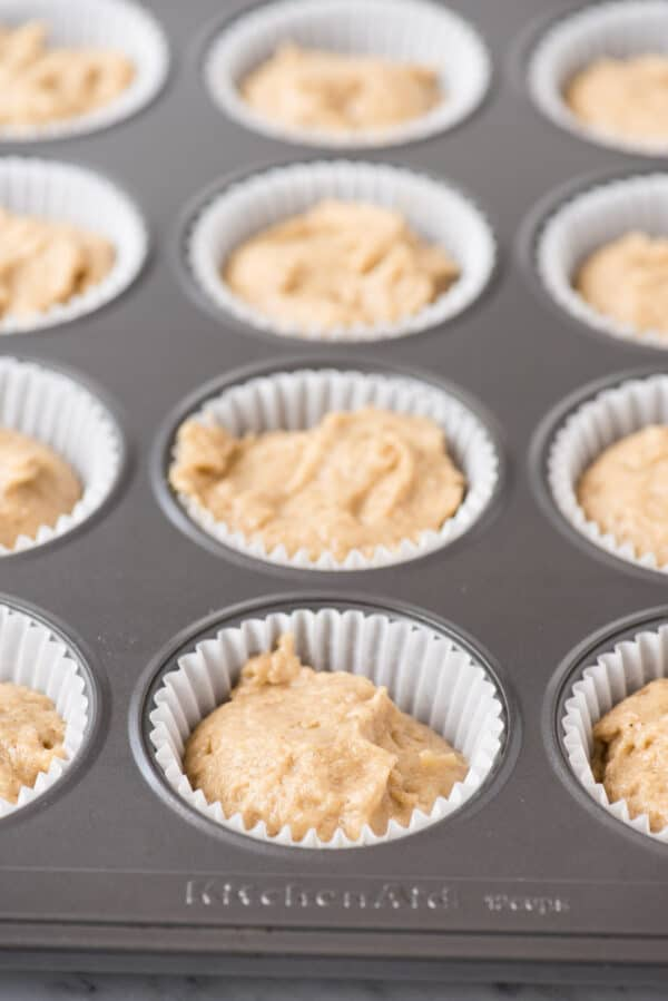 apple spice cupcake batter in metal muffin pan