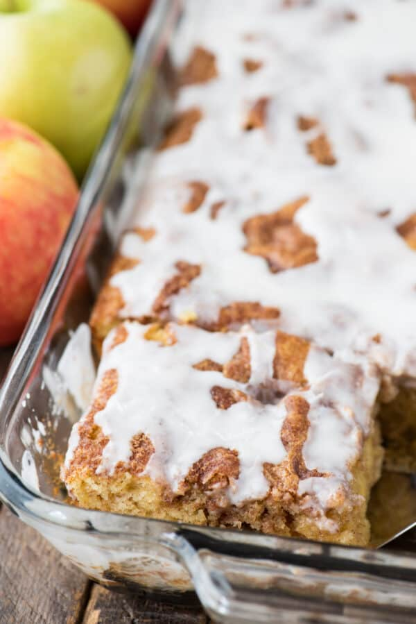apple coffee cake with white icing in glass 9x13 inch pan