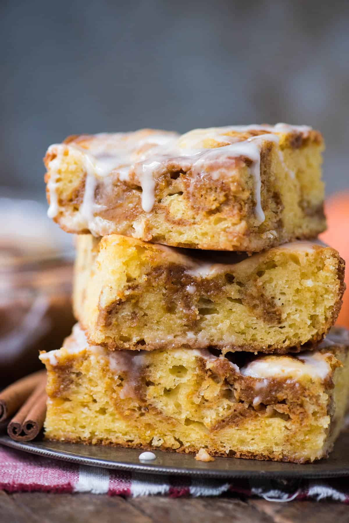 three pieces of pumpkin coffee cake stacked on top of metal plate