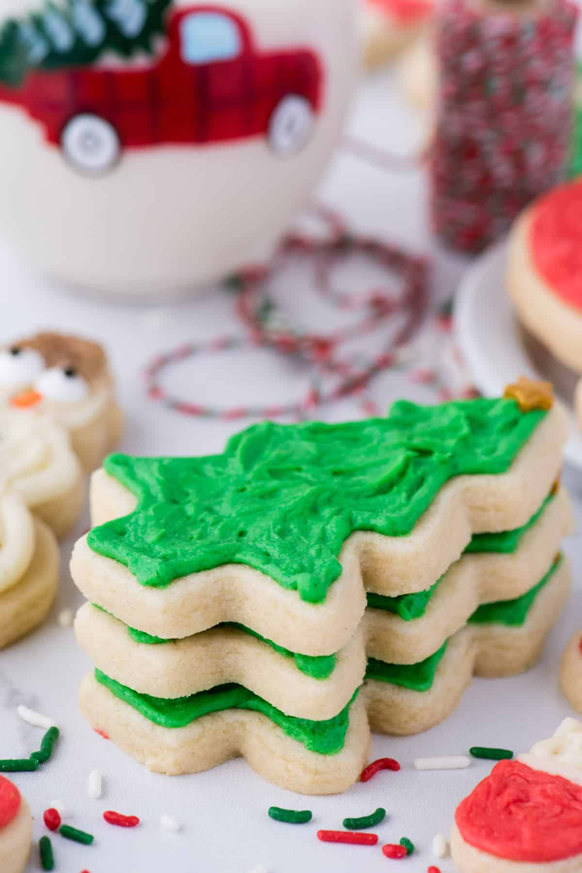 cut out christmas tree sugar cookies on white background