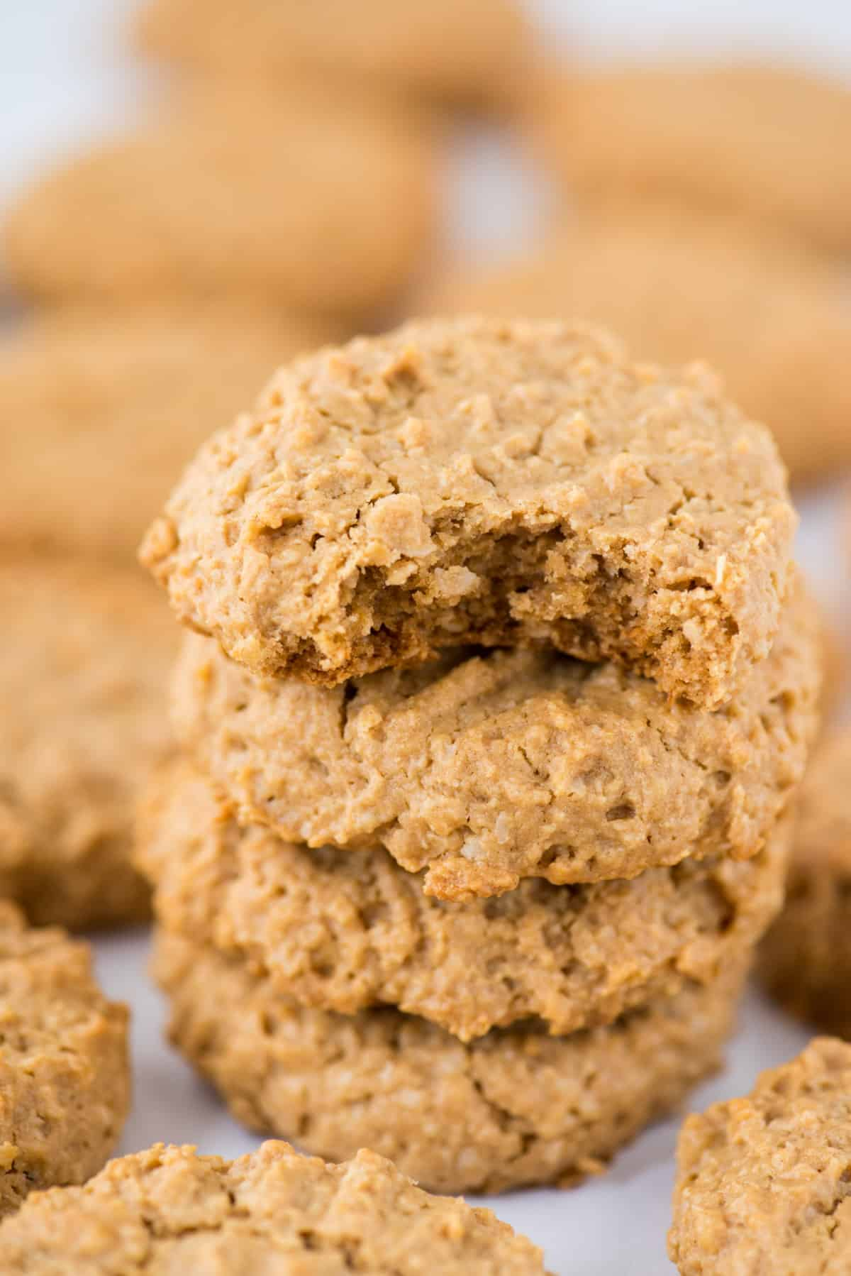 healthy peanut butter cookies in a stack on white background