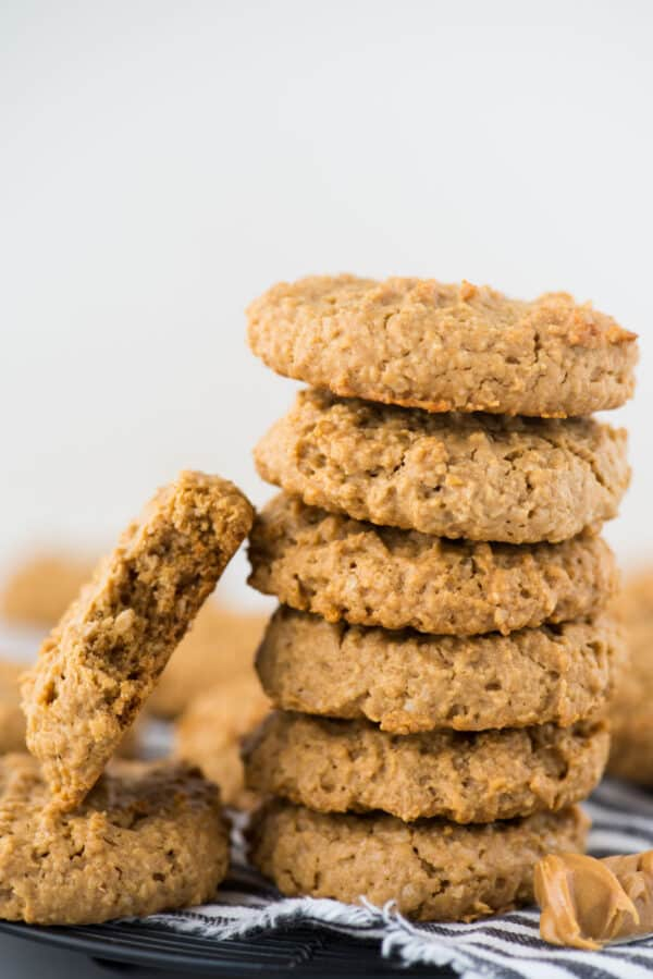 healthy peanut butter oatmeal cookies in a stack on white background