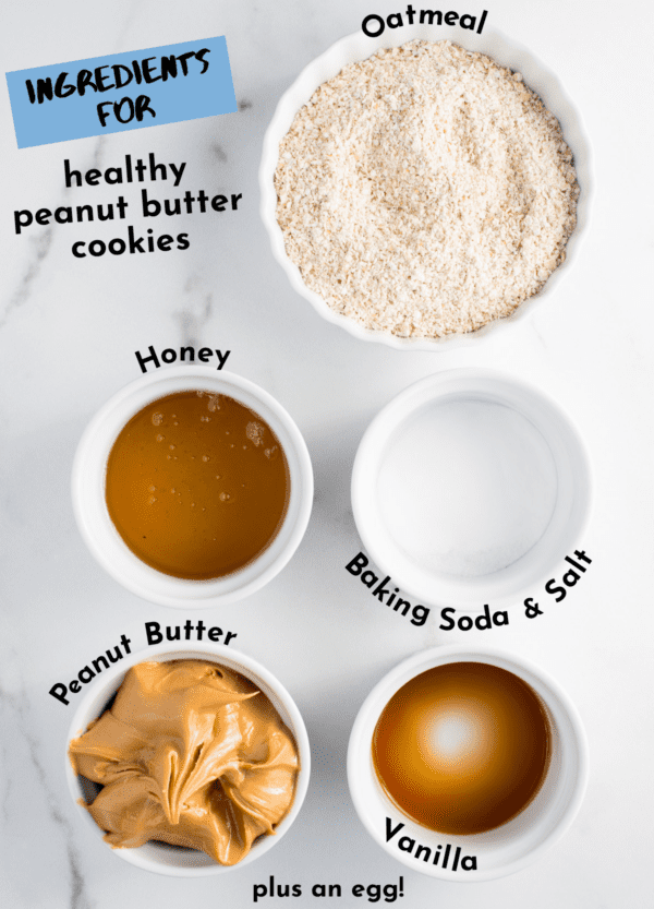 ingredients for healthy peanut butter cookies on white background