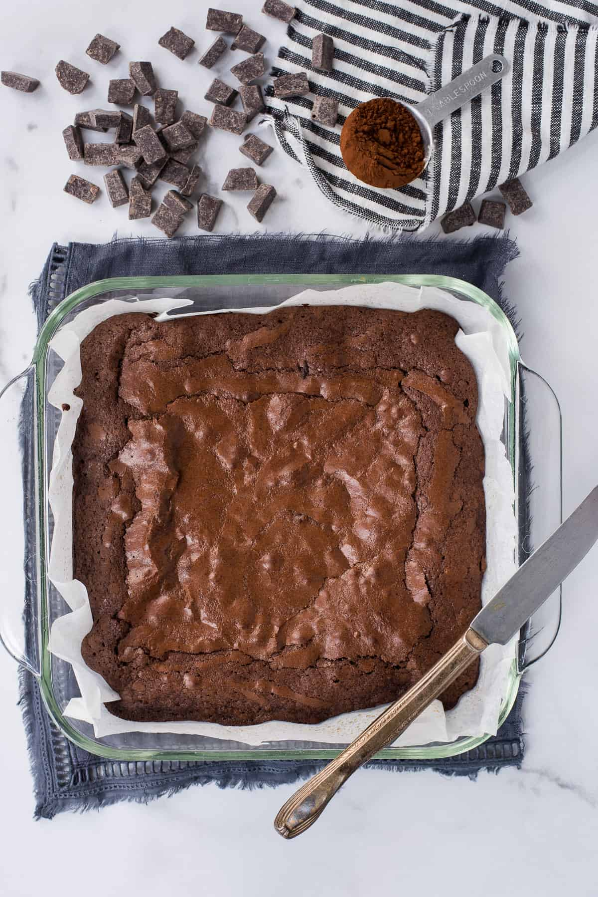 brownies in glass pan on white background