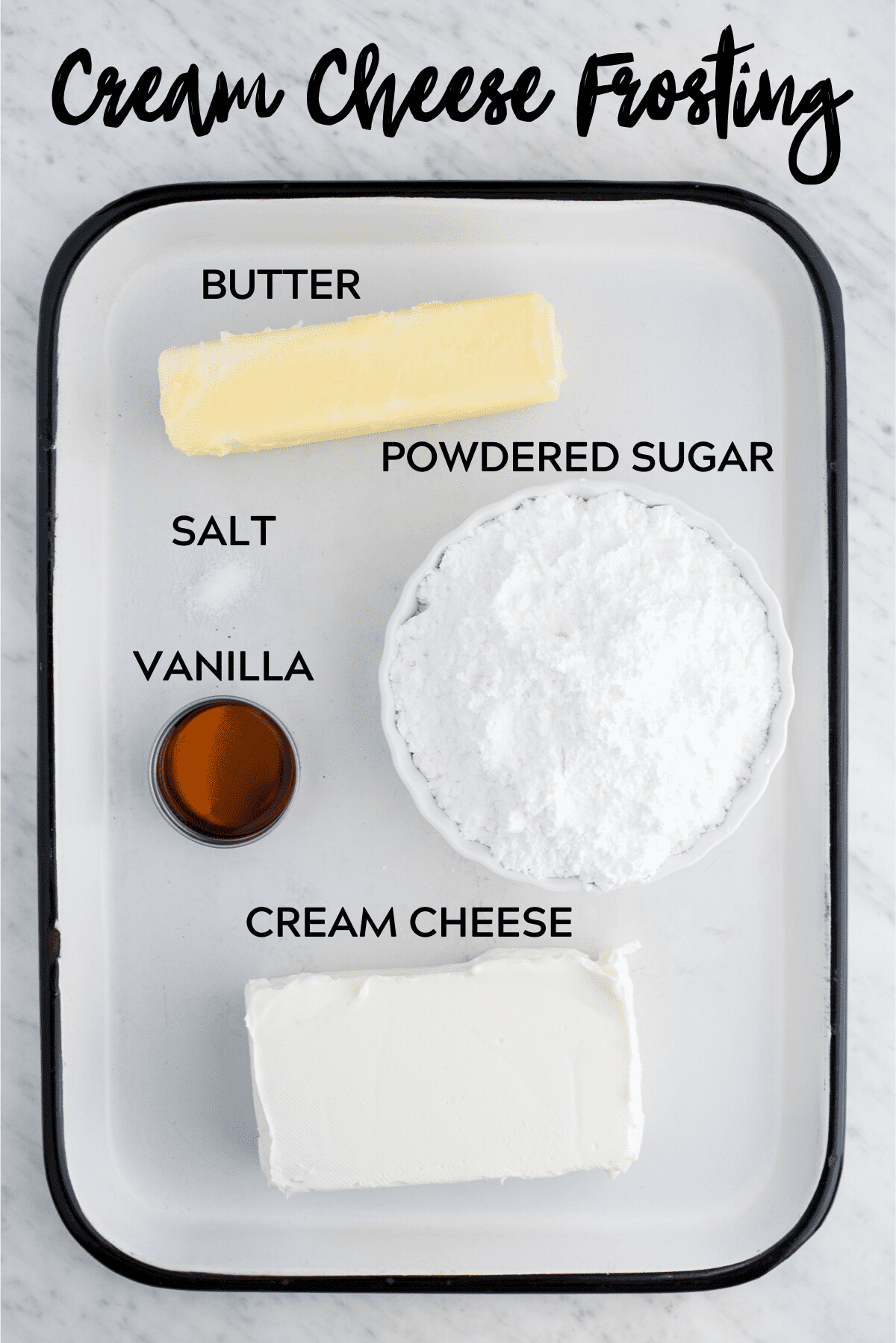 ingredients to make cream cheese frosting on white metal tray with text overlay