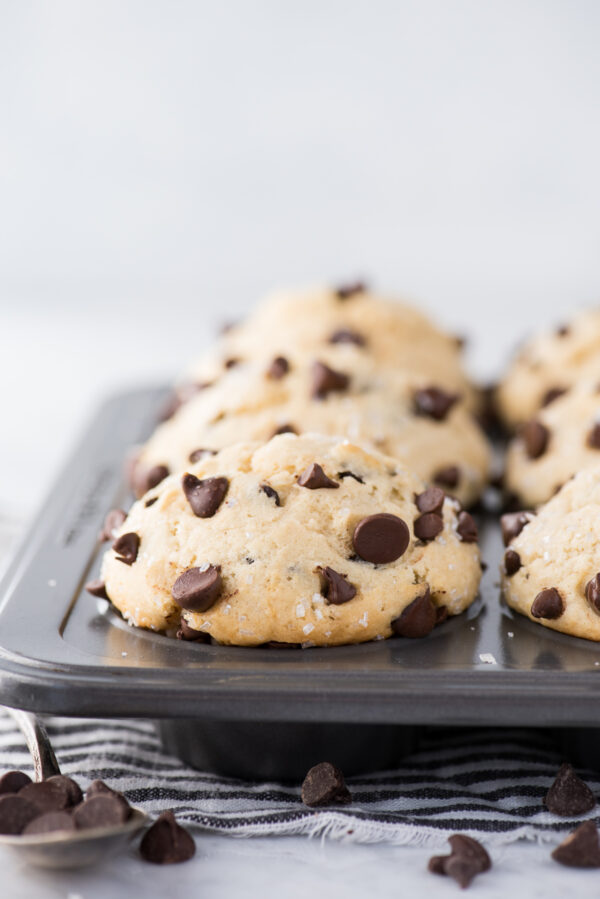 chocolate chip muffins with domed muffin tops in metal muffin pan