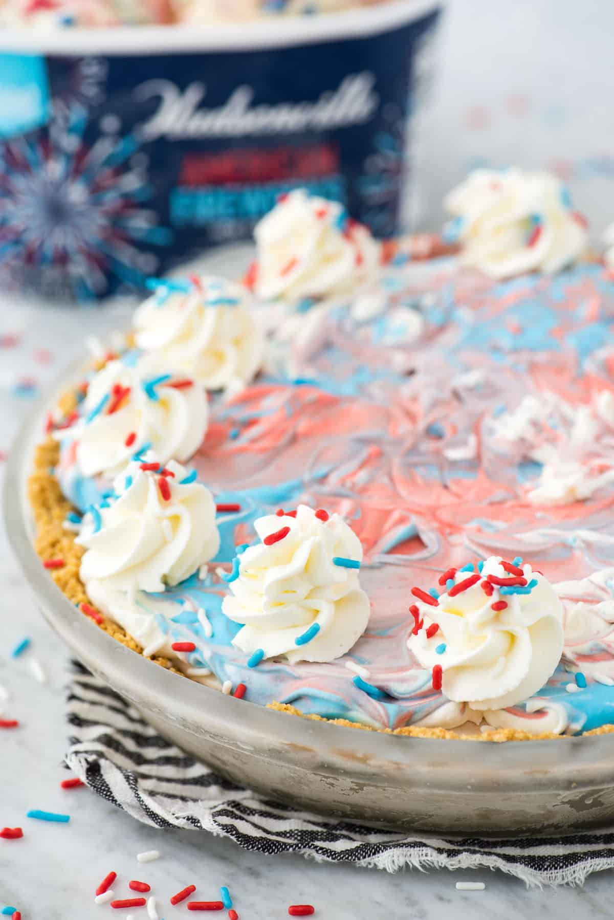 4th of july red, white and blue ice cream pie on blue stripe napkin