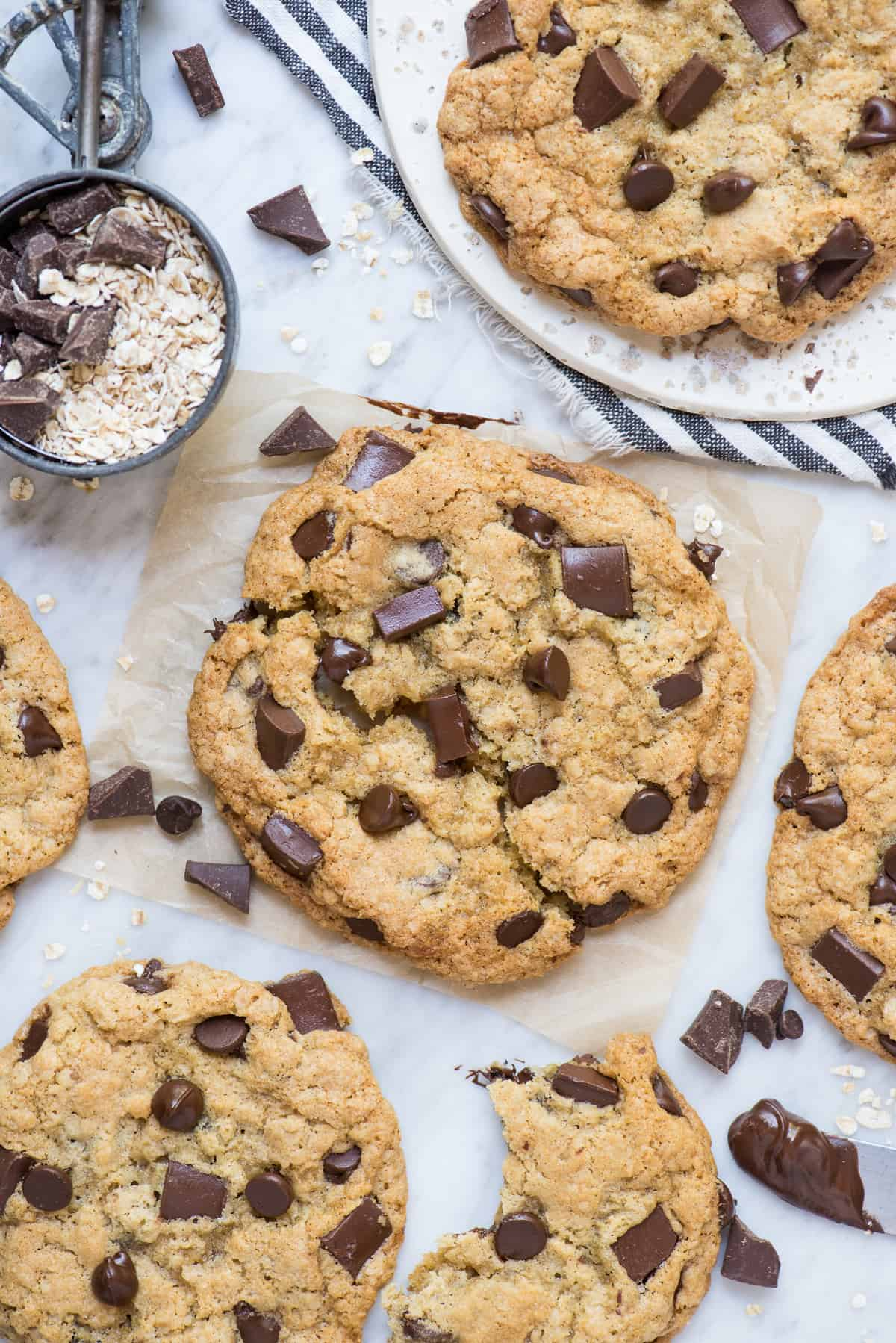 oatmeal chocolate chip cookies on white marble background
