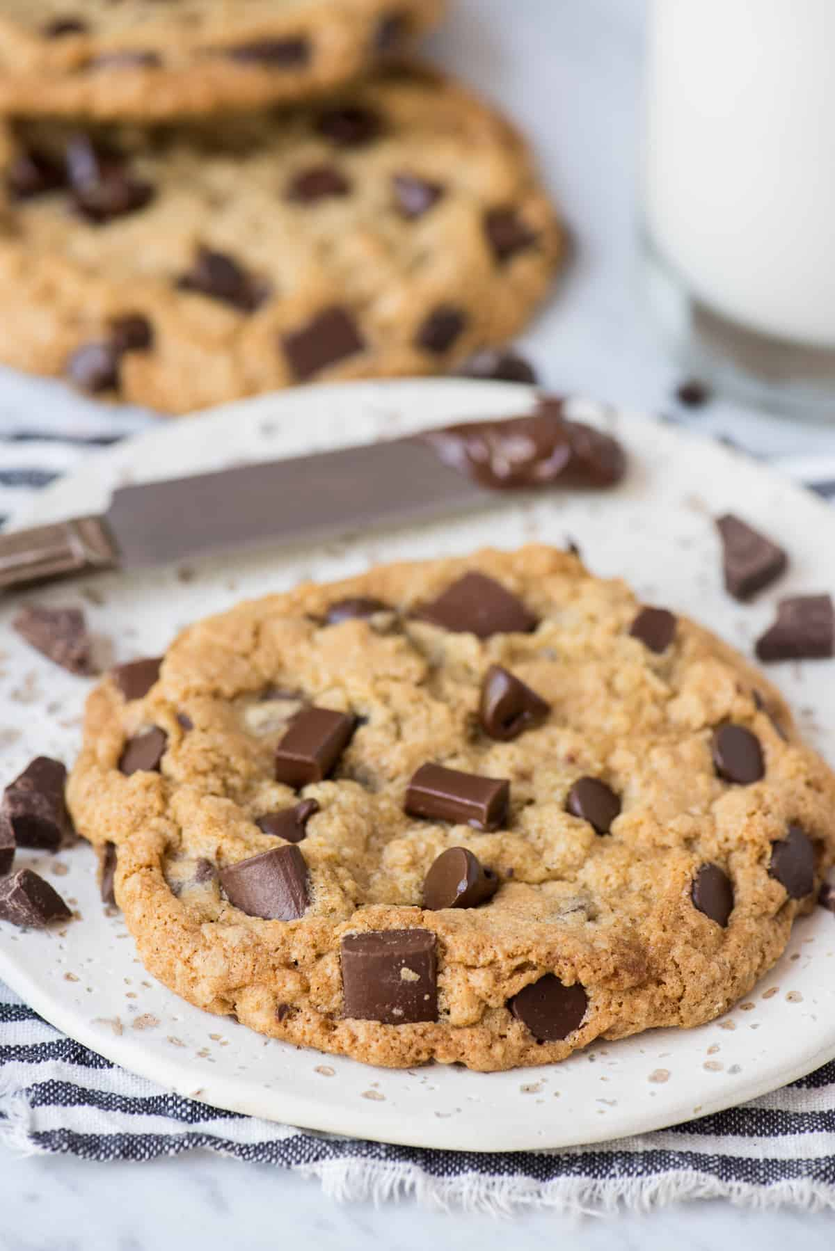 oatmeal chocolate chip cookie on round white plate