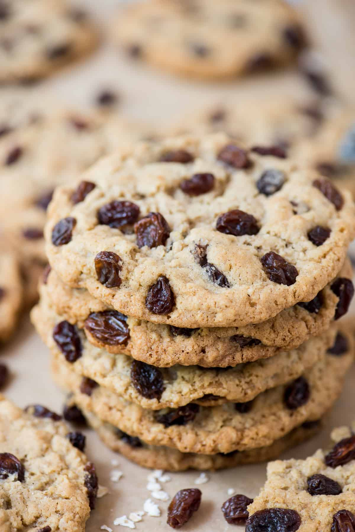 stack of oatmeal raisin cookies on brown parchment paper