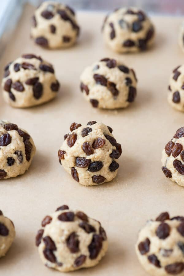 oatmeal raisin cookie dough balls on brown parchment paper