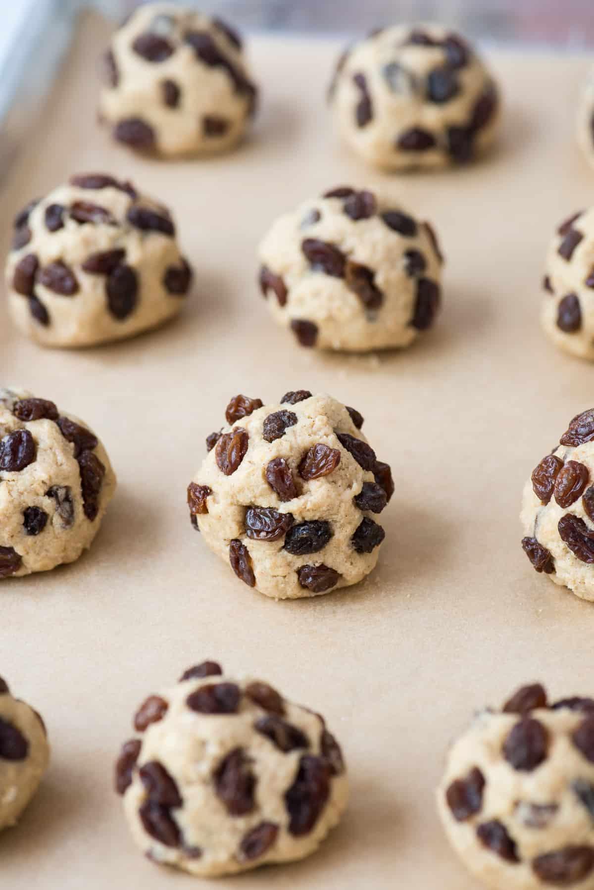 oatmeal raisin cookie dough balls on brown parchment paper