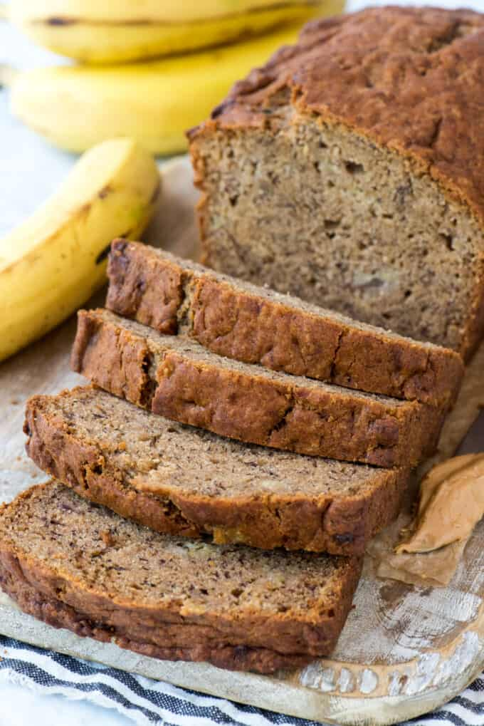 peanut butter banana bread slices on wood cutting board