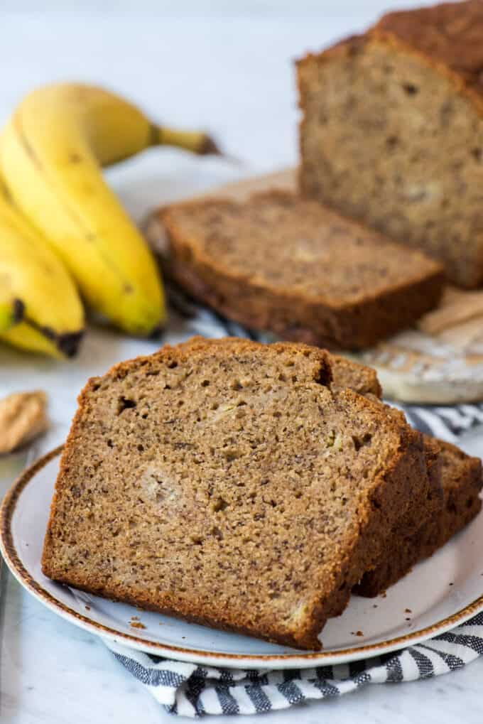 peanut butter banana bread on white plate with striped blue napkin