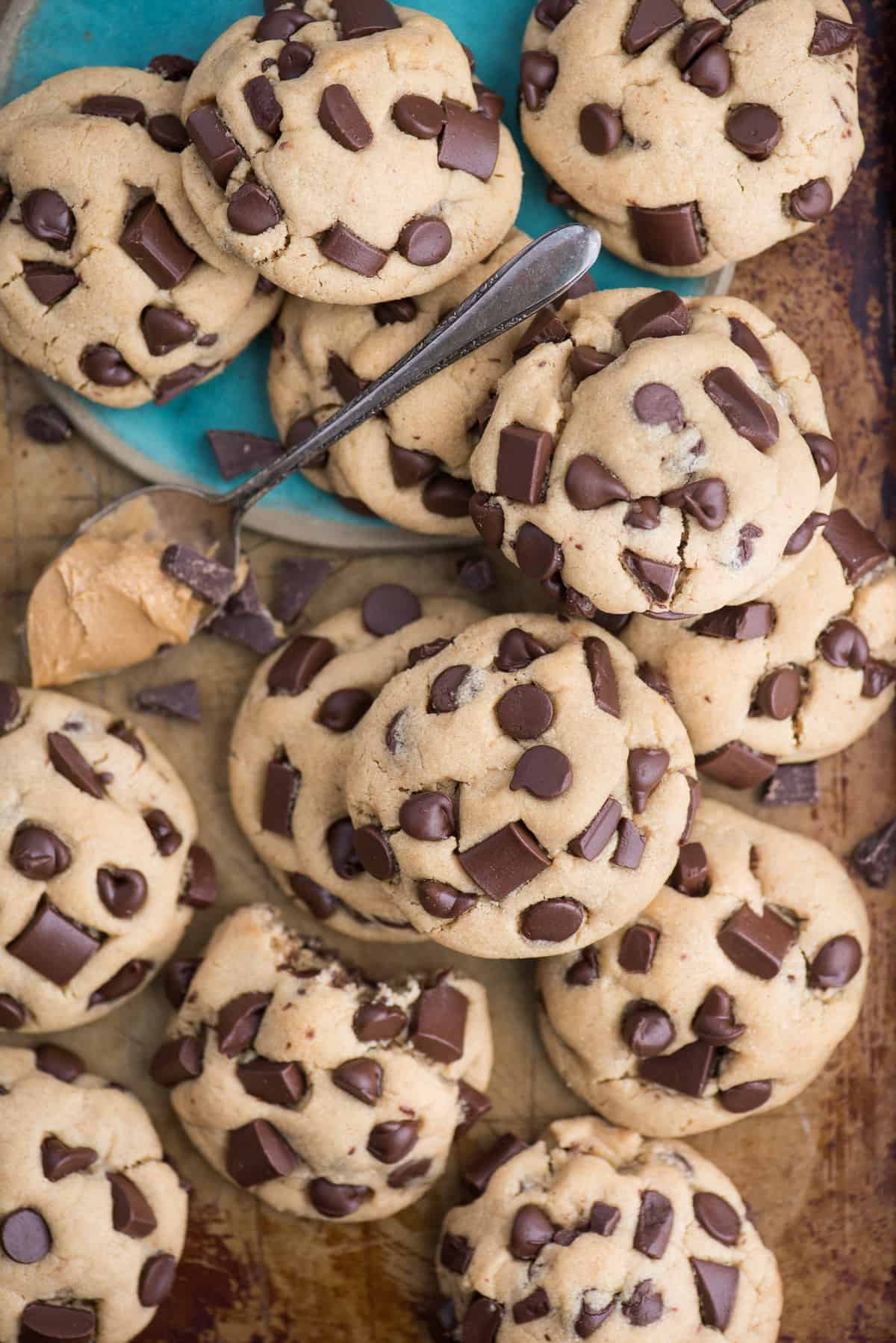 peanut butter chocolate chip cookies on a brown metal cookie sheet