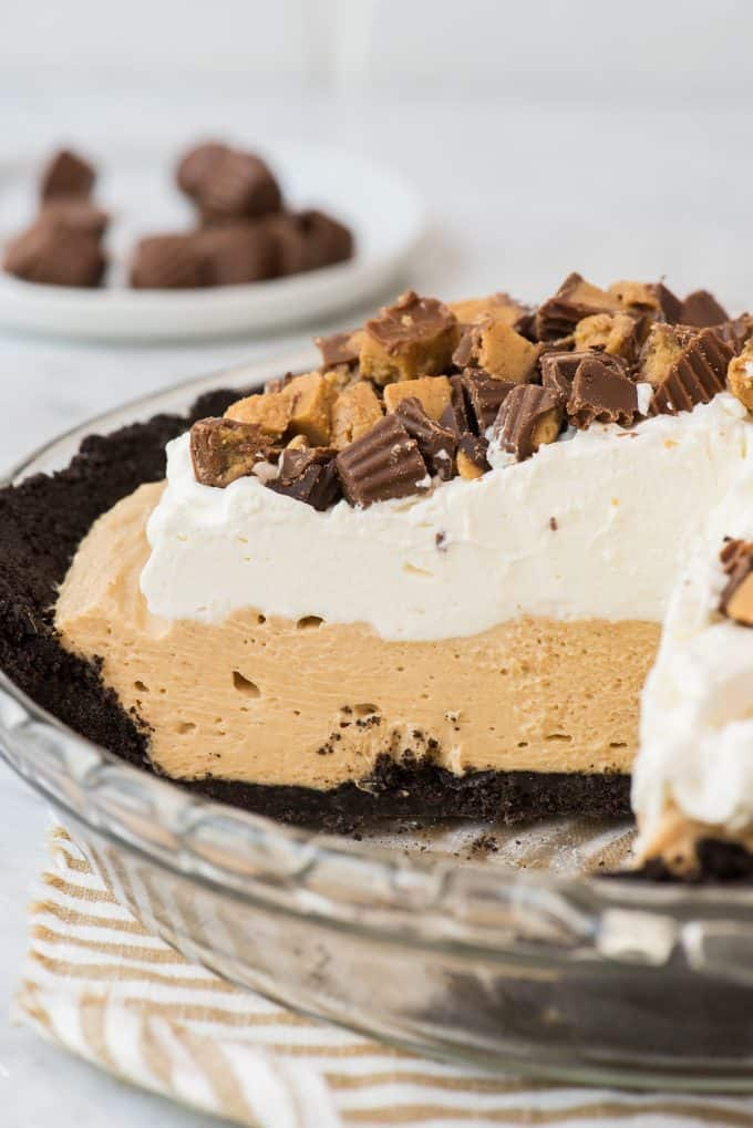 peanut butter pie with slice removed on white background