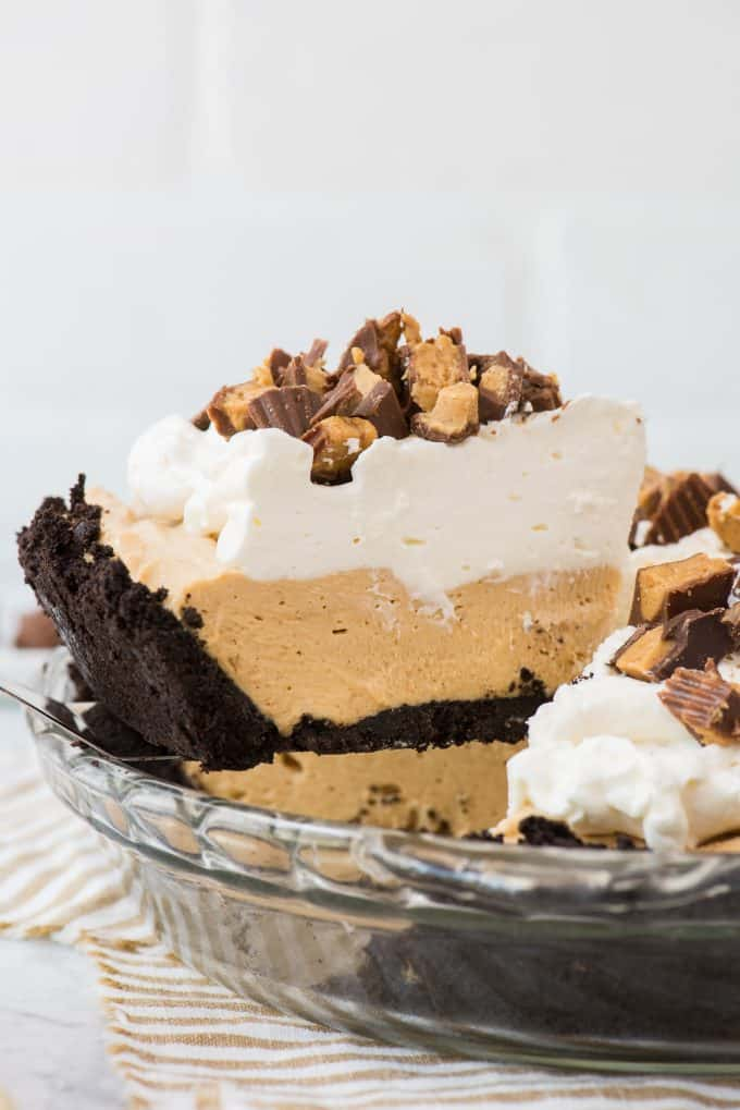 slice of peanut butter pie on spatula being removed from pie pan