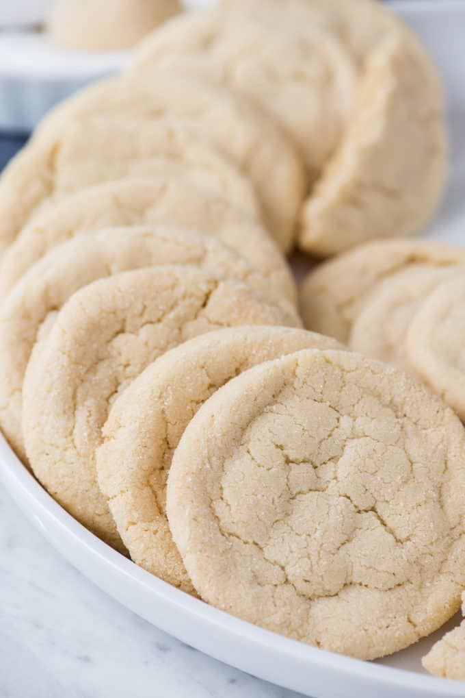 amish sugar cookies lined up in a curve on white platter