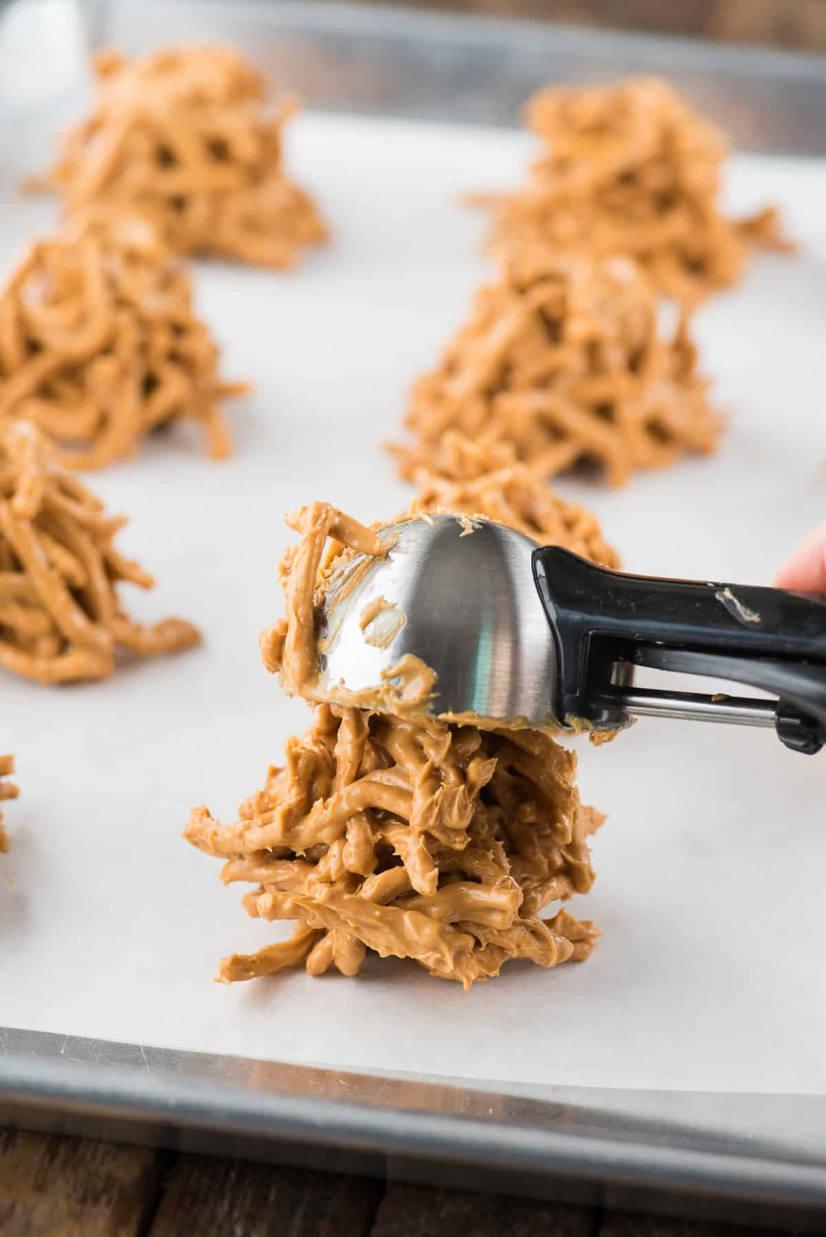 butterscotch haystack cookies on white parchment paper