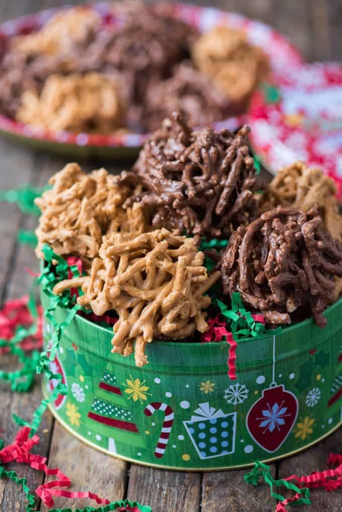 haystack cookies arranged in green christmas cookie tin