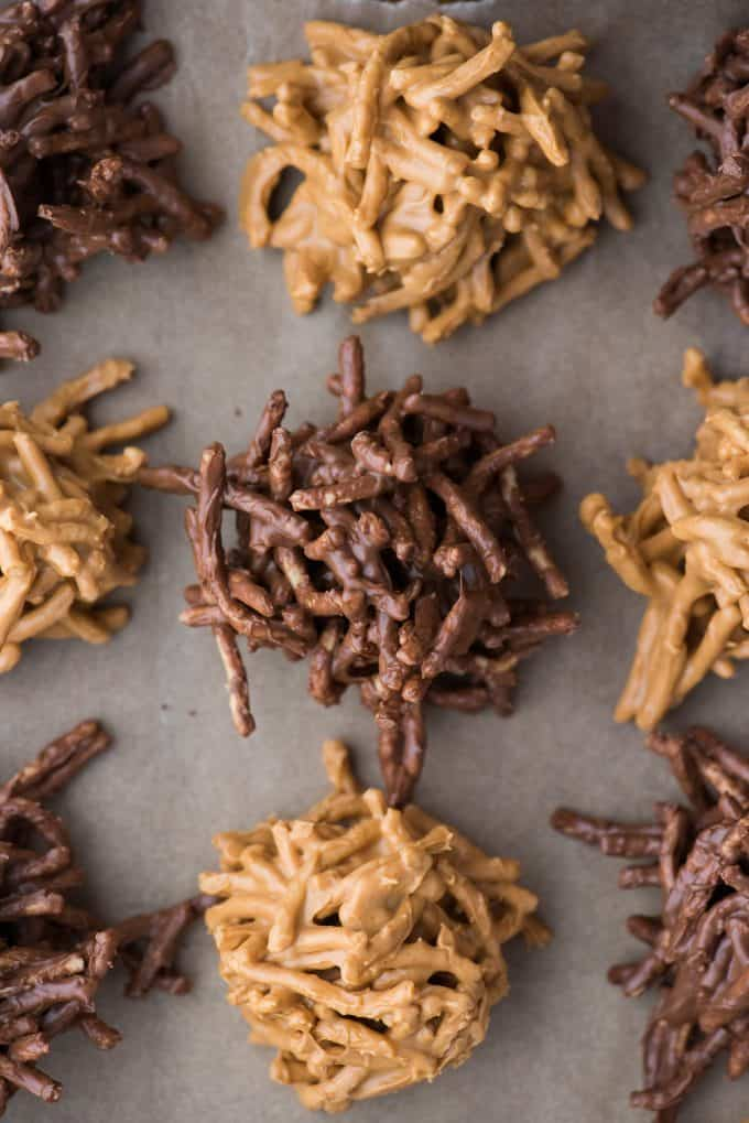 butterscotch haystack cookies and chocolate haystack cookies arranged on brown parchment paper