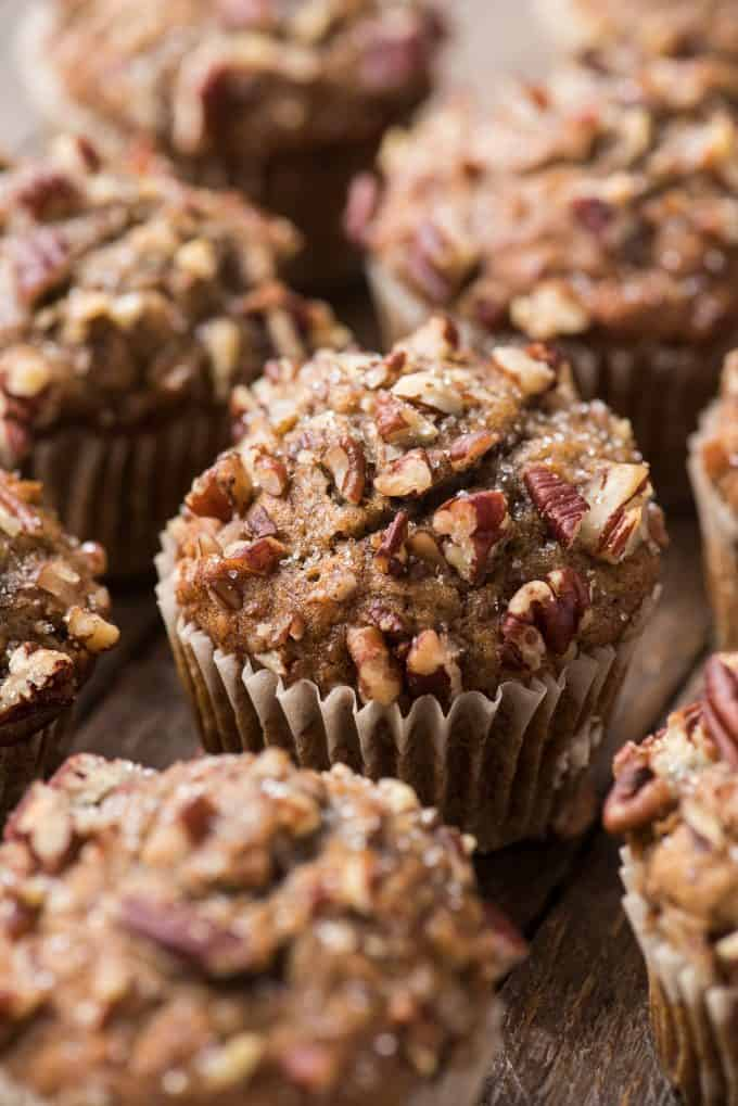 banana nut muffins arranged in rows on dark wood background