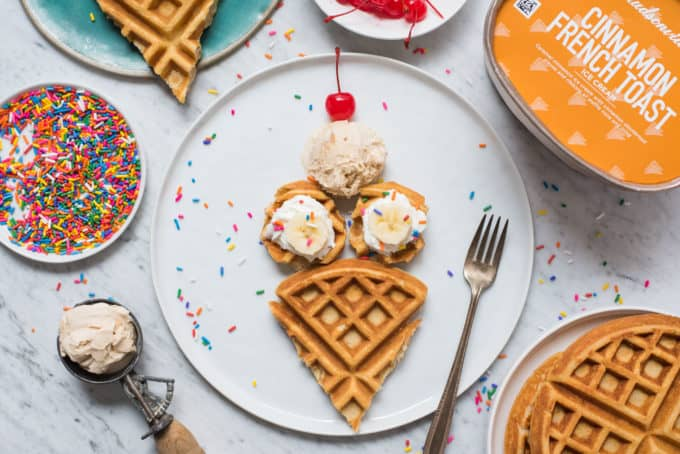 waffles cut and arranged in the shape of an ice cream cone on white plate on white background