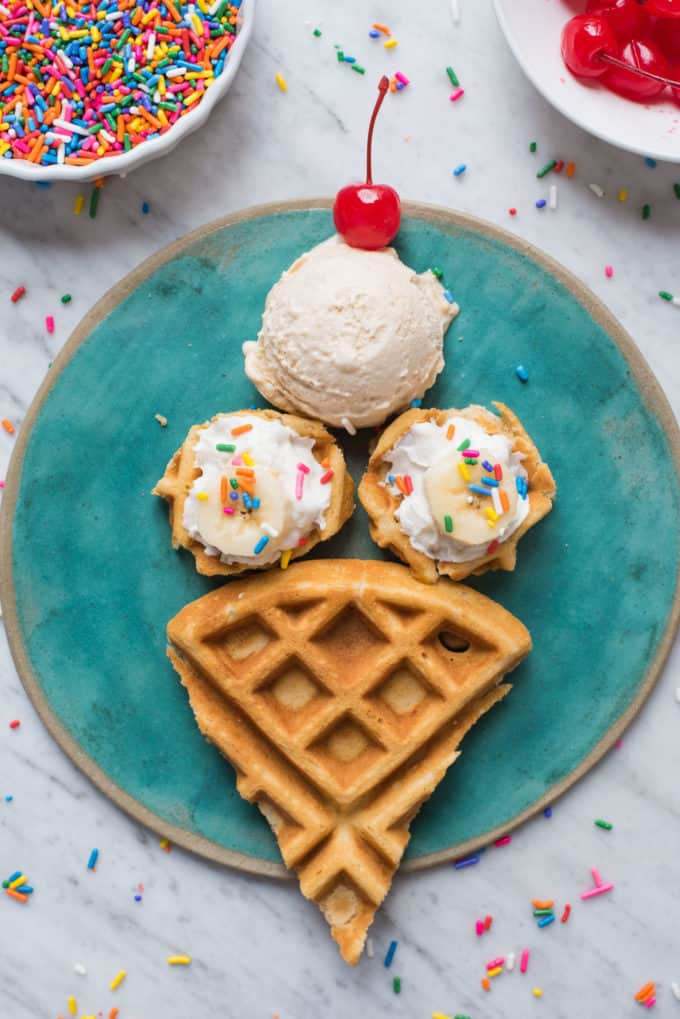 waffles cut and arranged in the shape of an ice cream cone on teal plate on white background