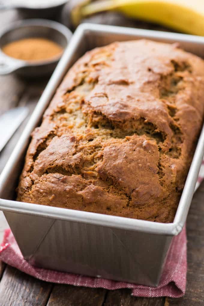 whole loaf of banana bread in metal loaf pan
