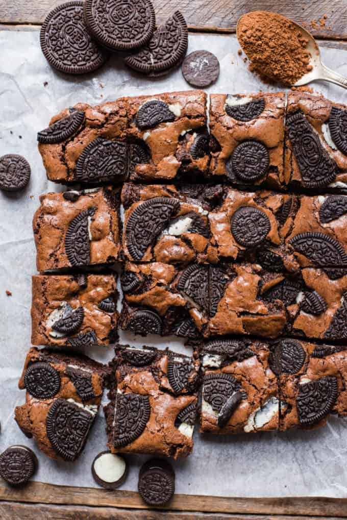 oreo brownies cut into squares and arranged on white parchment paper