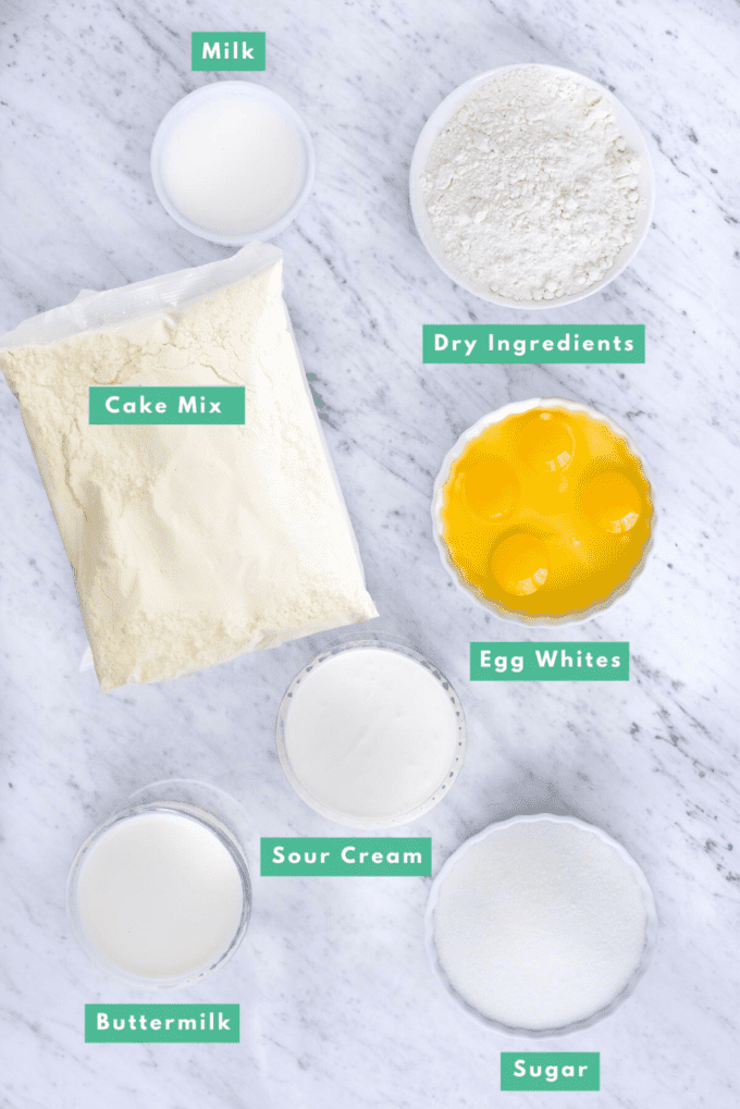 ingredients to make yellow cake from yellow cake mix on white background