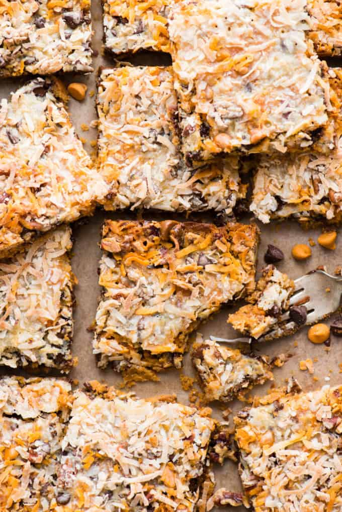 hello dolly bars cut into squares and arranged on a metal baking sheet