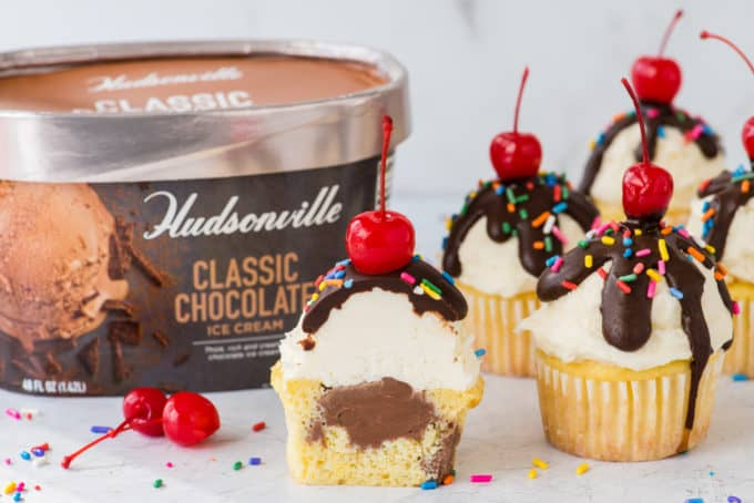 ice cream cupcakes arranged on white surface with Hudsonville ice cream container in the background