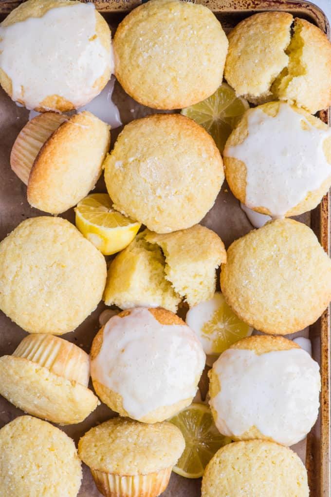 lemon muffins arranged in a grid on a metal baking sheet