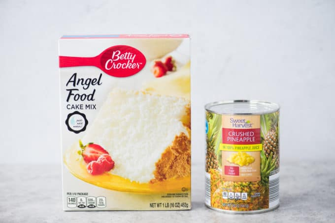 box of angel food cake mix and can of crushed pineapple on white background