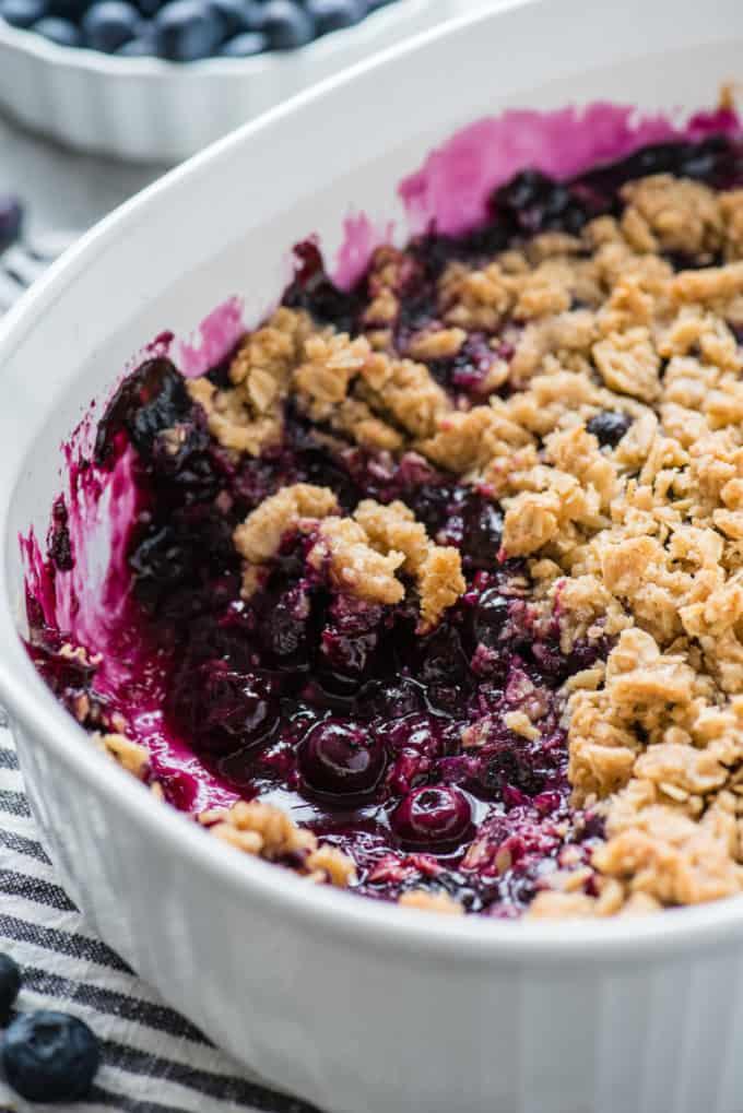 blueberry crisp in a white baking dish