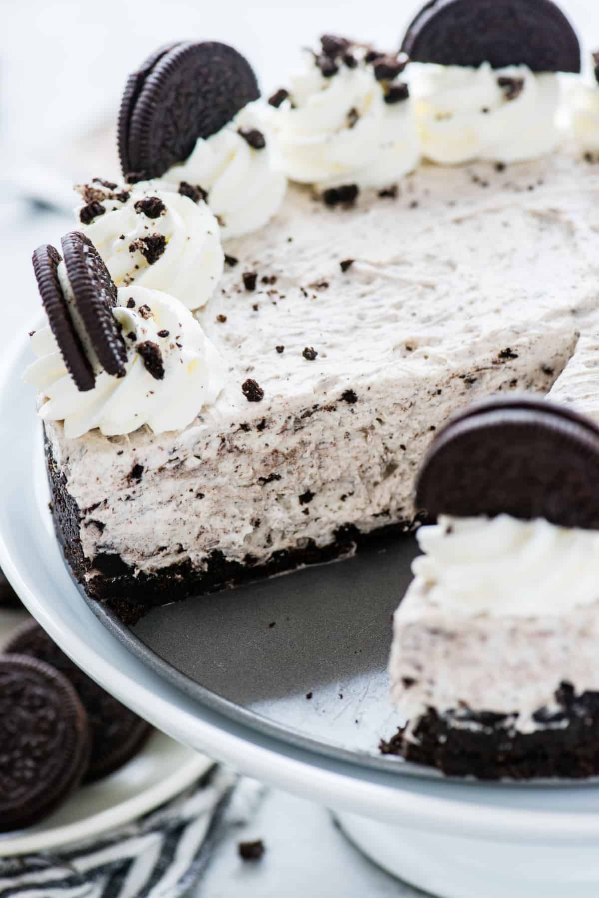 no bake oreo cheesecake in a springform pan with a slice removed