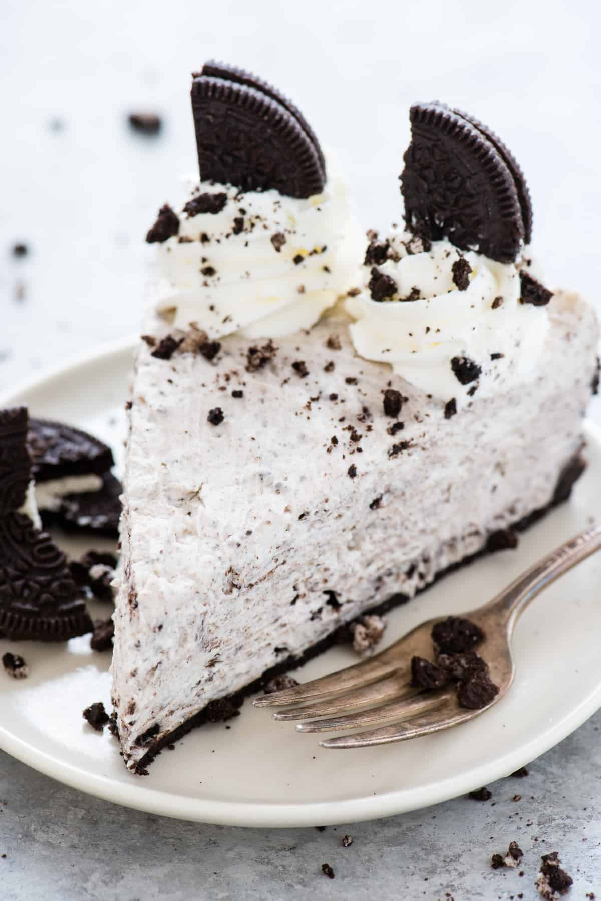 a slice of no bake oreo cheesecake on a white plate