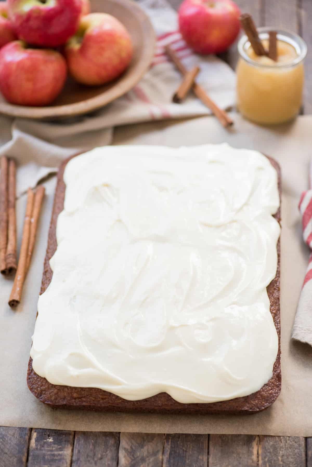 whole applesauce cake topped with cream cheese frosting