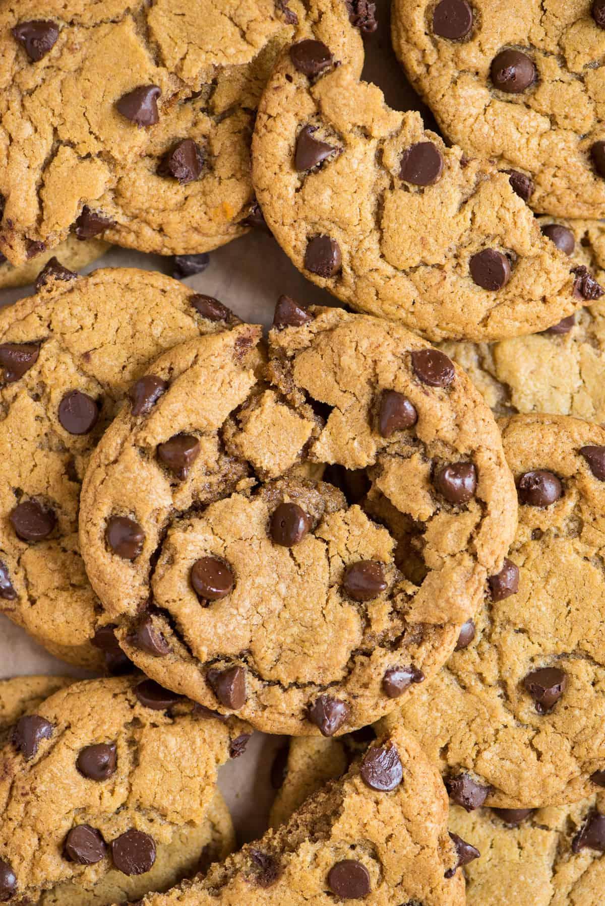pumpkin chocolate chip cookie arranged on top of more cookies