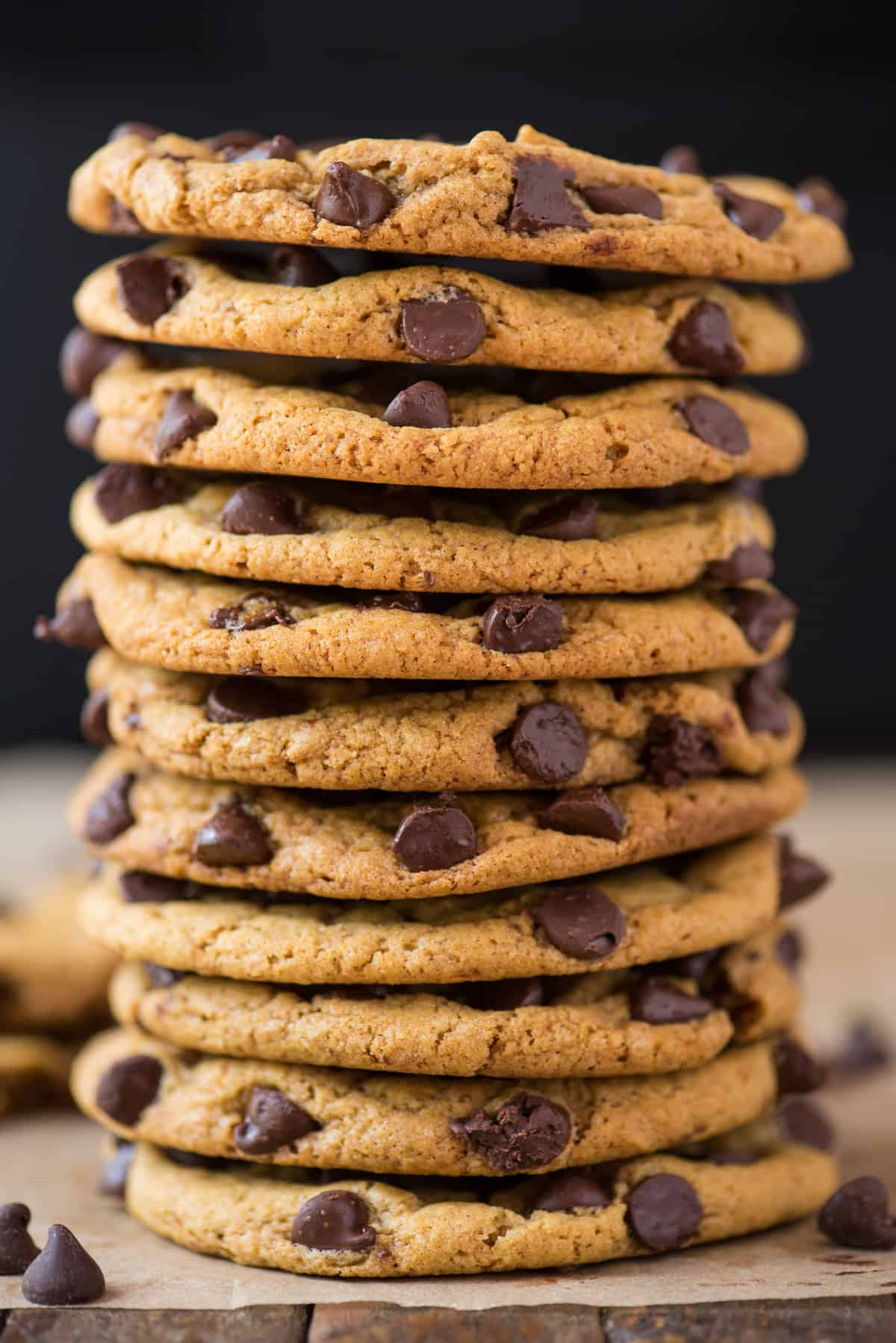 pumpkin chocolate chip cookies stacked on top of each other