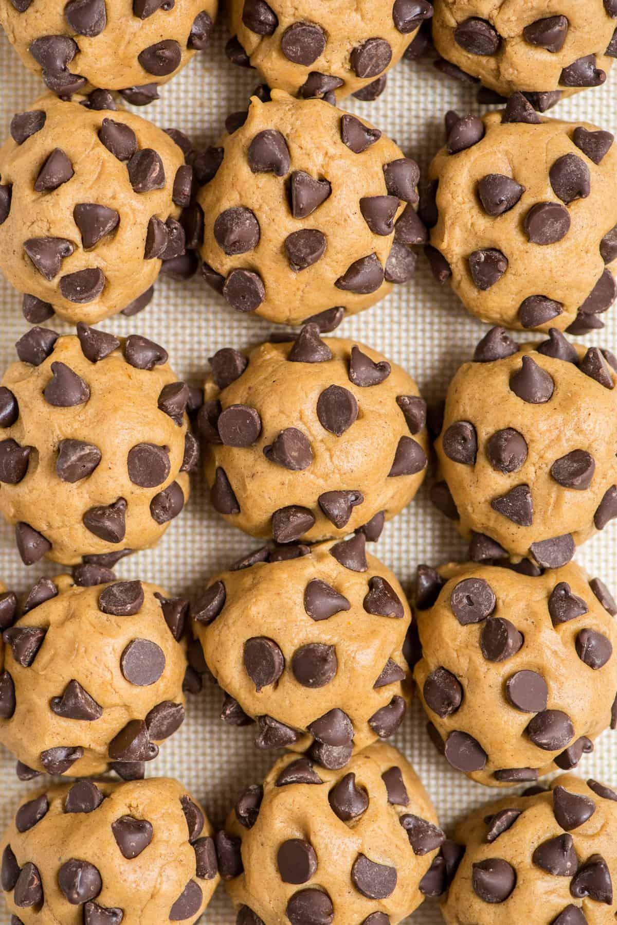 pumpkin chocolate chip cookie dough balls arranged in grid