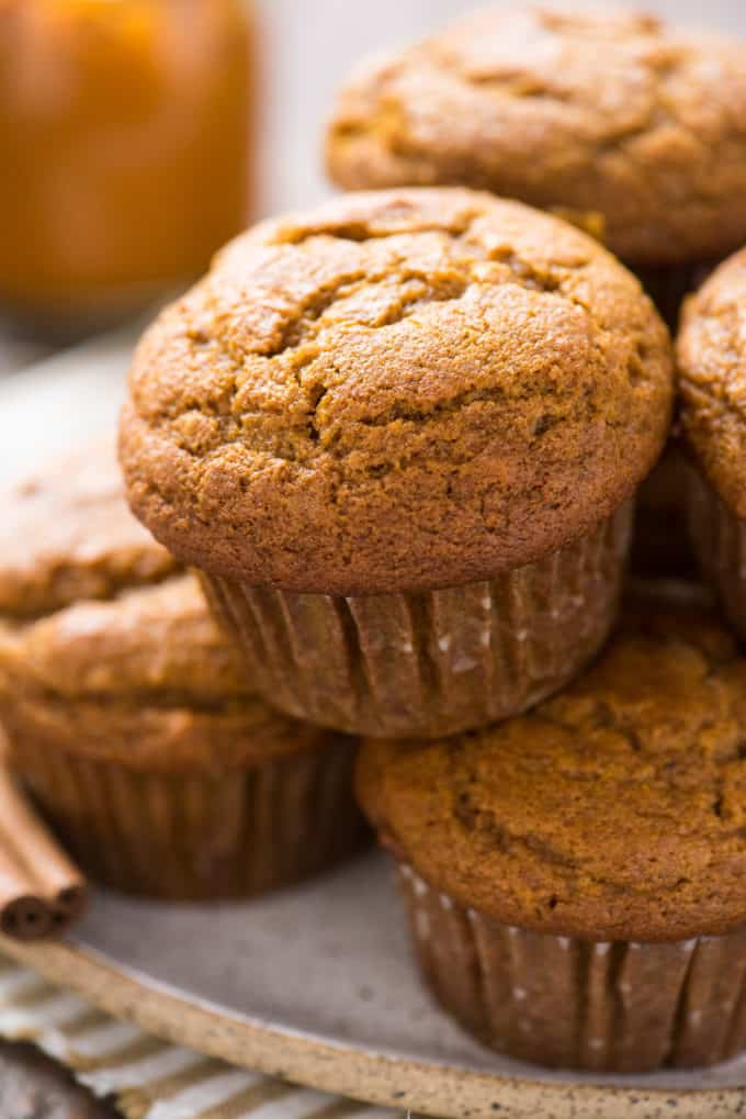pumpkin muffins arranged in a tower on white plate